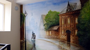 Подъезды дома в жилом районе «Гармония» украсила художественная роспись