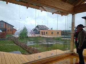 Безрамное остекление от Мастерской Безрамных Конструкций на выставке Open Village