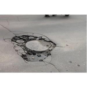 Активисты ОНФ взяли на контроль решение проблемы просевших люков на дорогах Орла