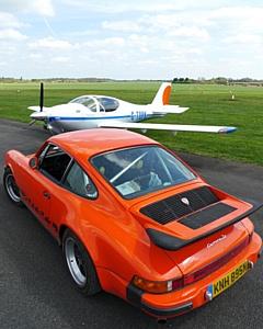 Соревнования между автомобилями Porsche, реактивным самолетом и вертолетом